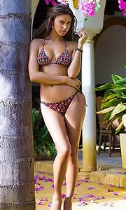 Irina Sheik poses outdoors