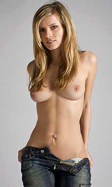 Erotic Blonde Posing In Denim Pants